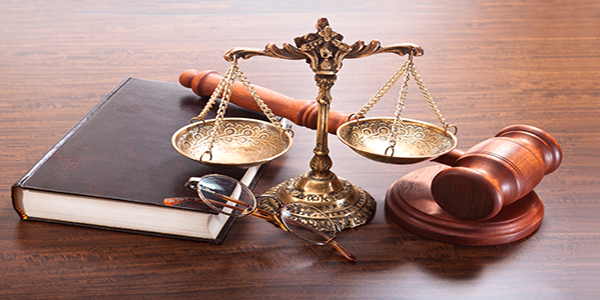 A gavel, book and a balance