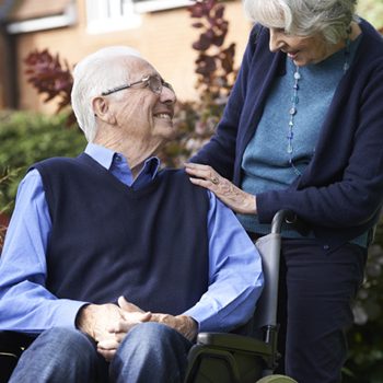 Older couple; man in wheelchair with woman